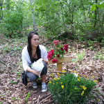 Elijah's girlfriend Madison visits the woods where he died